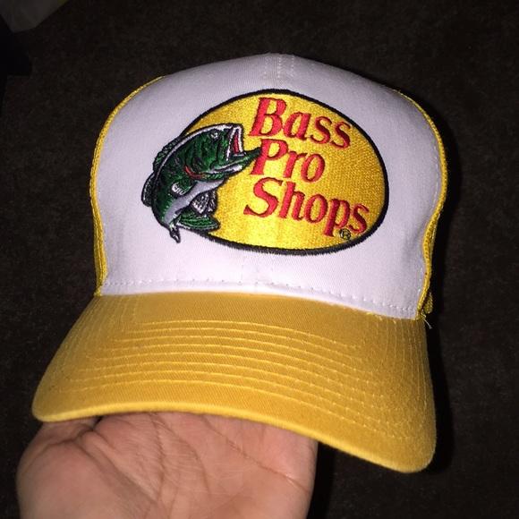 c426b91f BASS PRO SHOPS HAT yellow trucker hat. M_5a6d39fcfcdc313e9eca876c. Other  Accessories ...